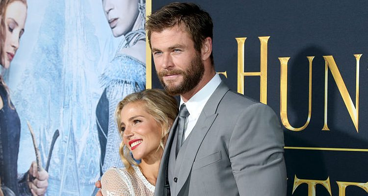 """Chris Hemsworth and Wife Elsa Pataky's Family Outing: Hunky """"Thor"""" Flaunts Muscular Arms as He Cradles His Children"""